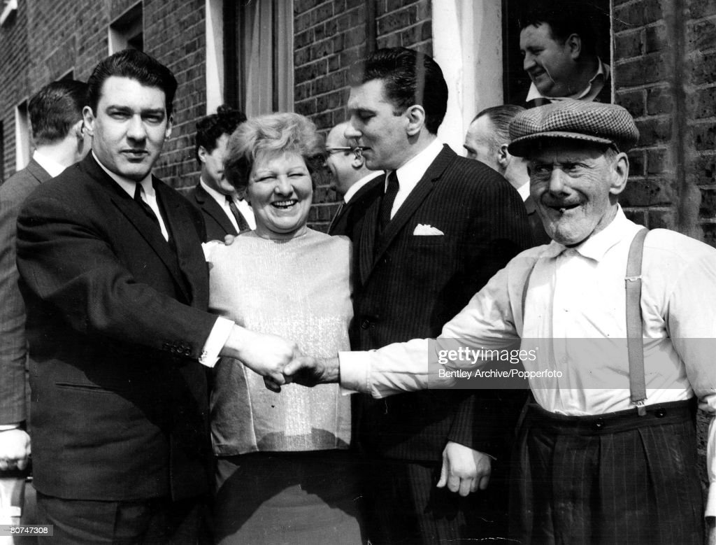 England 1960s East End London gangsters, the Kray twins pictured outside their house in Vallance Road. They are L-R: Ronnie, their mother Violet, Reggie and Grandfather Jimmy Lee. : News Photo