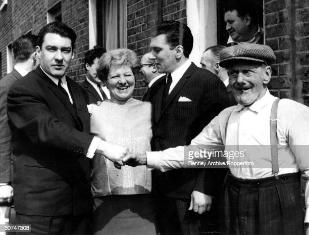 England 1960s East End London gangsters the Kray twins pictured outside their house in Vallance Road They are LR Ronnie their mother Violet Reggie...