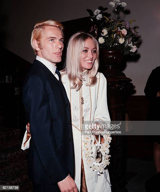 England 19th August 1967 British actor and singer Adam Faith is pictured with his new wife Jackie Irving after their wedding at Caxton Hall