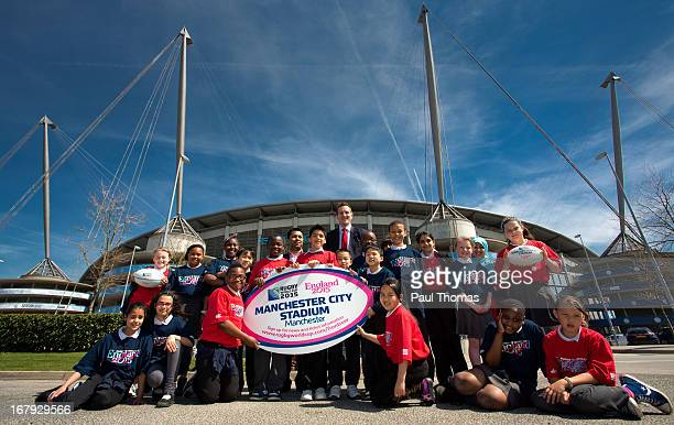 England 2015 ambassador Will Greenwood and Councillor Luthfur Rahman pose with Ashbury Meadow Primary School pupils during the IRB Rugby World Cup...
