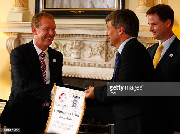 England 2018 CEO Andy Anson presents a pennant to the Leader of the FIFA inspection team Harold Mayne Nicholls at an England 2018 World Cup bid event...