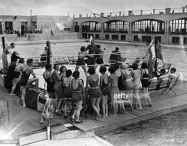 England 20th May 1934 Young female boxers engage in the art of self defence on a floating boxing ring at Hastings