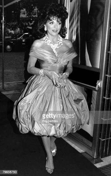 England 21st June 1987 British actress Joan Collins arrives for a London film premier wearing a fashionable satin puffball evening dress