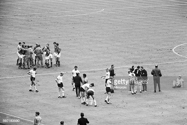 England 4 v West Germany 2 after extra time England manager Alf Ramsey tries to lift the spirits of his players as they take refreshement in the...