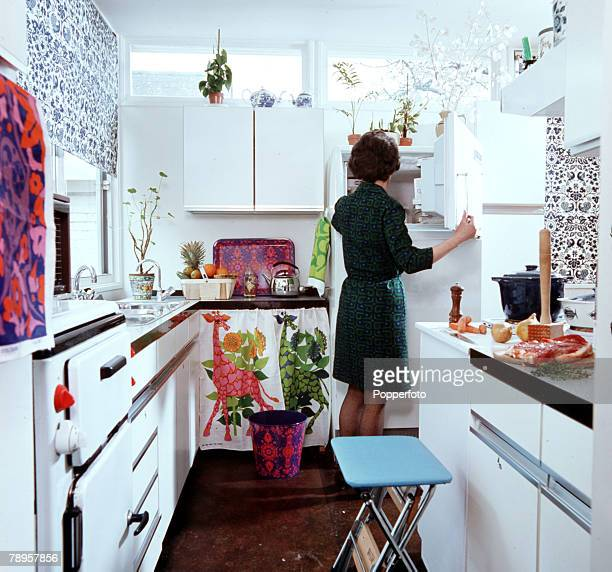 England A housewife is pictured making a meal in her kitchen
