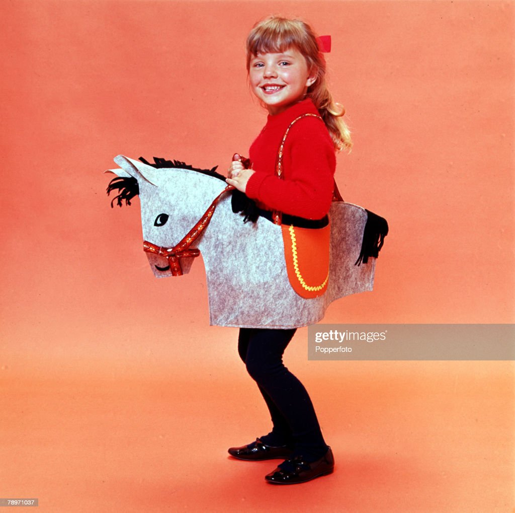 England, 1967, A little girl is pictured riding a toy rocking horse