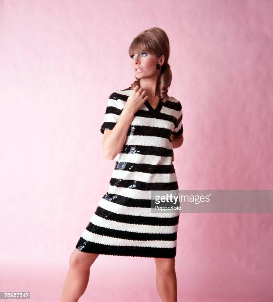 England A model is pictured wearing a black and white dress with sequins