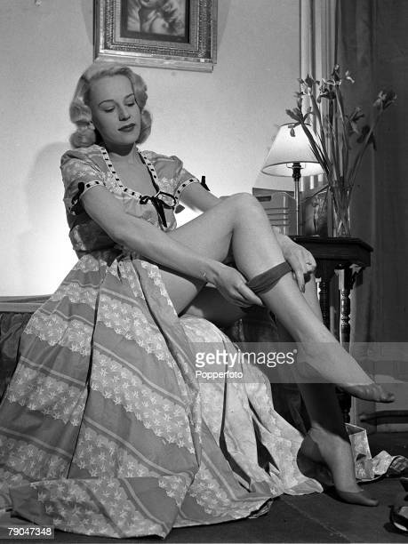 1949 England A picture of British actress Patti Morgan demonstrating how to put on a pair of nylon stockings