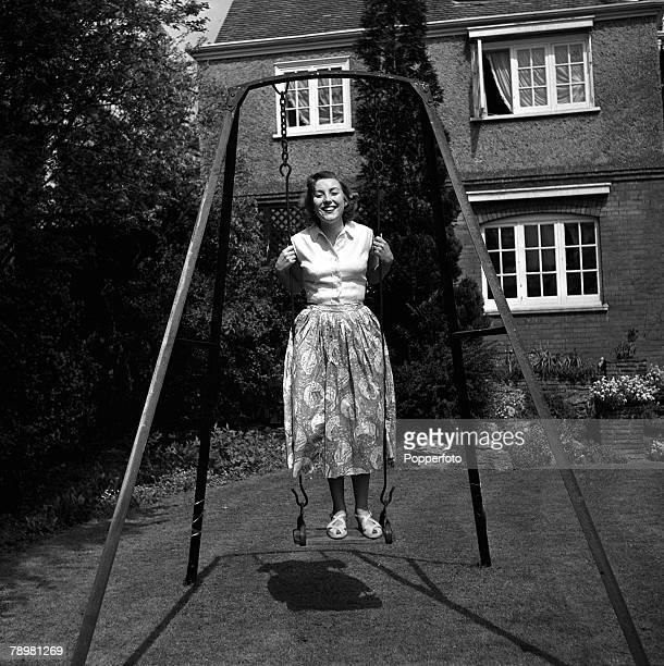 1952 England A picture of British singer Vera Lynn standing on a swing in her garden