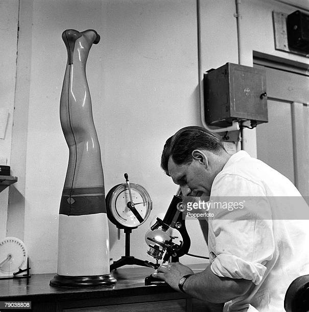 England A scientist examines a nylon stocking through a microscope to research the longevity of the material