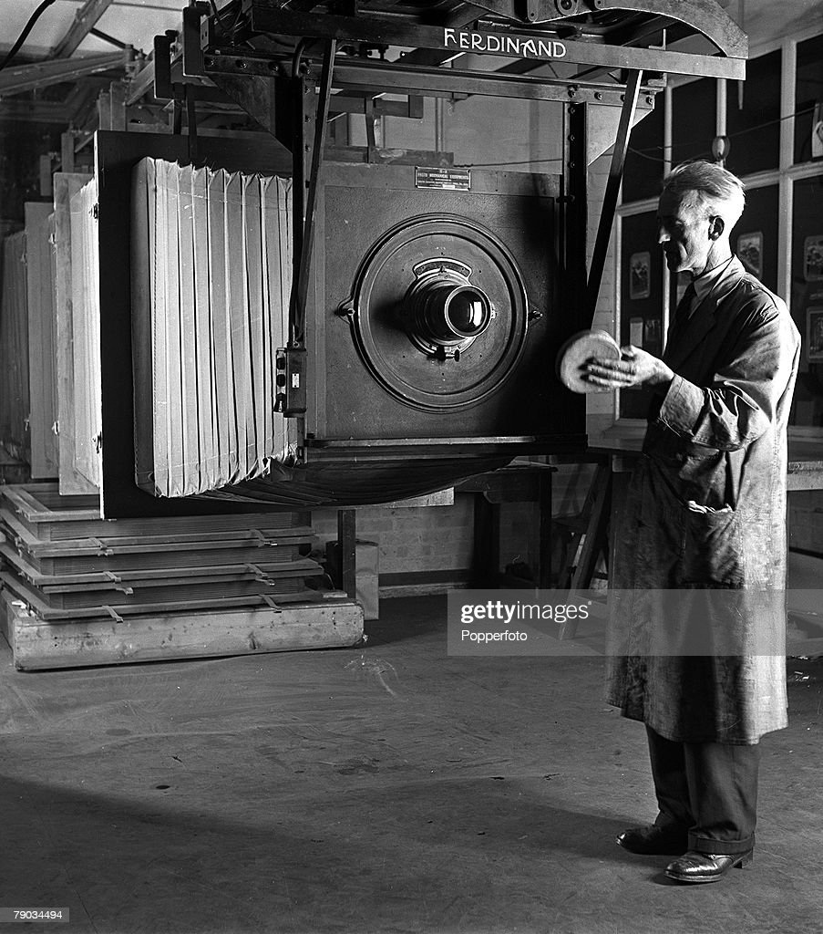 England, 1949, A worker operates one of two giant cameras used by the Ordnance Survey at Crabwood for copying large maps