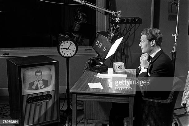 England Actor television broadcaster and newsreader Alex Macintosh is pictured looking at himself on a television monitor