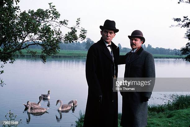 England Actors Edward Hardwicke playing the role of Doctor Watson and Jeremy Brett as Sherlock Holmes are pictured in a scene from the Granada...