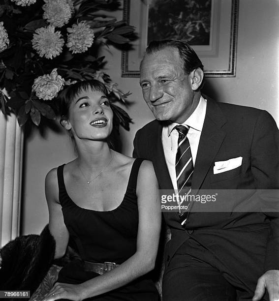 England Actress Elsa Martinelli is pictured with actor Trevor Howard at a press reception at the Mayfair Hotel for the film Manuela