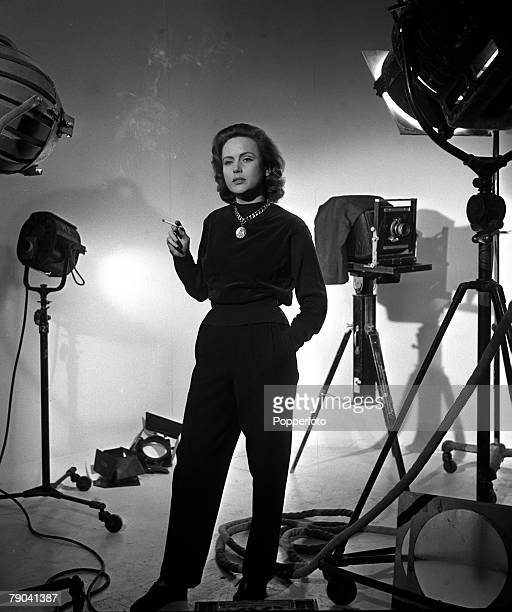 England Actress Nadia Gray is pictured smoking a cigarette in the studio