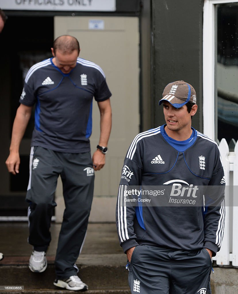 England Alastair Cook and caoch Andy Flower walk on to the outfield to inspect the ground as rain delays the start of play on day five of the Test match between New Zealand and England at Basin Reserve on March 18, 2013 in Wellington, New Zealand.