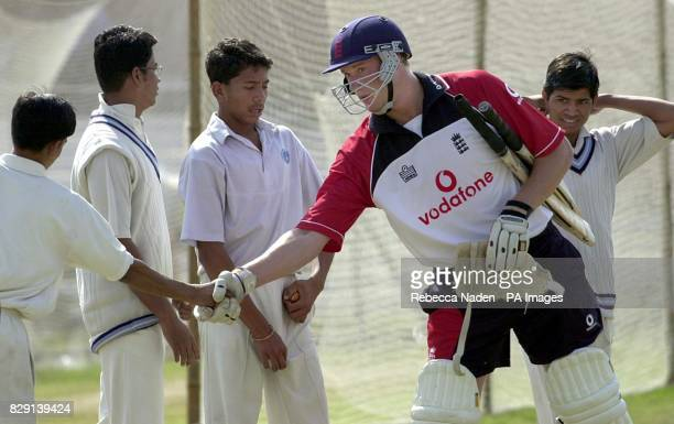 England allrounder Andrew Flintoff shakes hands with the young school boys who bowled to him at net practice in Jaipur ahead of the test match series...