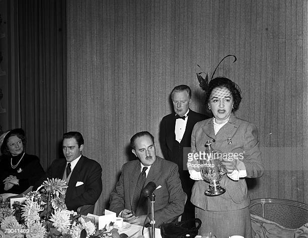 England American actress Bebe Daniels prepares to present the Picturegoer Gold Cup award to British actor Richard Todd for his performance in the...