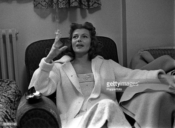 England American actress Rita Hayworth is pictured smoking a cigarette