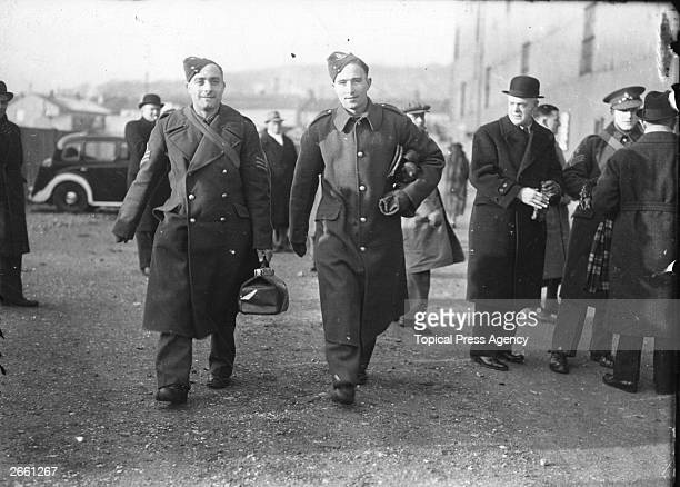 England and Arsenal footballers Sergeant Wilf Copping left and Gunner Denis Compton arrive in uniform at Selhurst Park to play for the Army team...
