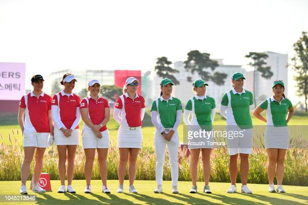 England and Australia players line up on the first tee for the national anthems prior to the Pool A match between England and Australia on day one of...