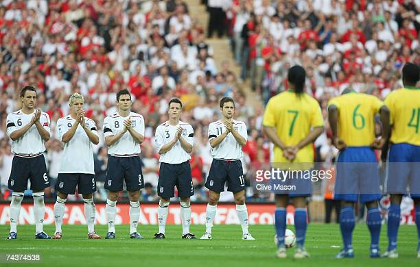 England and Brazil players stand in the centre circle as Alan Ball is remembered prior to the International Friendly match between England and Brazil...