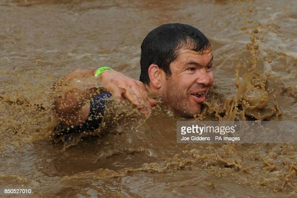 England and British and Irish Lions assistant coach Andy Farrell take part in Tough Mudder 2013 at Boughton House Kettering