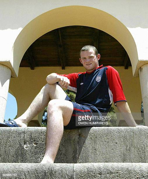 England and Everton striker Wayne Rooney poses for photos between training sessions during preparations for the game against Switzerland in the Euro...