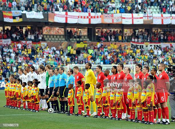 England and German teams with referee and assistants line up before the start of the 2010 FIFA World Cup South Africa Round of Sixteen match between...