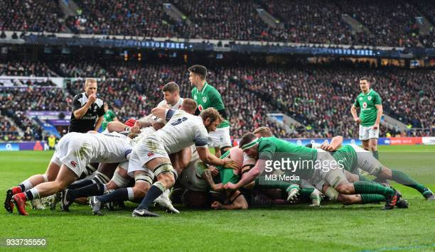 England and Ireland forwards contest a scrum during the NatWest Six Nations Championship match between England and Ireland at Twickenham Stadium on...