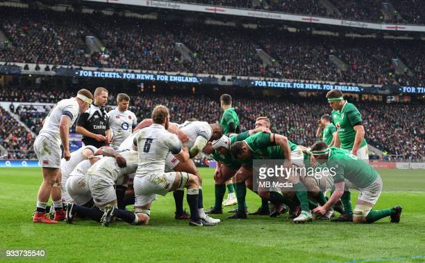 England and Ireland forwards prepare for a scrum during the NatWest Six Nations Championship match between England and Ireland at Twickenham Stadium...