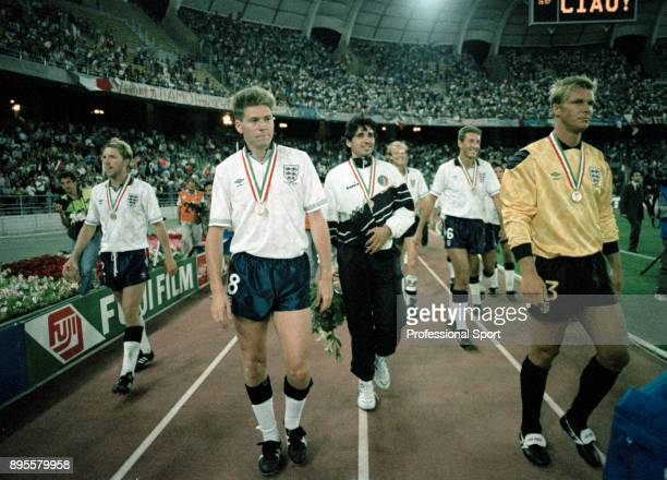 England and Italy players do a lap of honour after the FIFA World Cup 3rd Place play-off at Stadio San Nicola on July 07, 1990 in Bari, Italy. In...