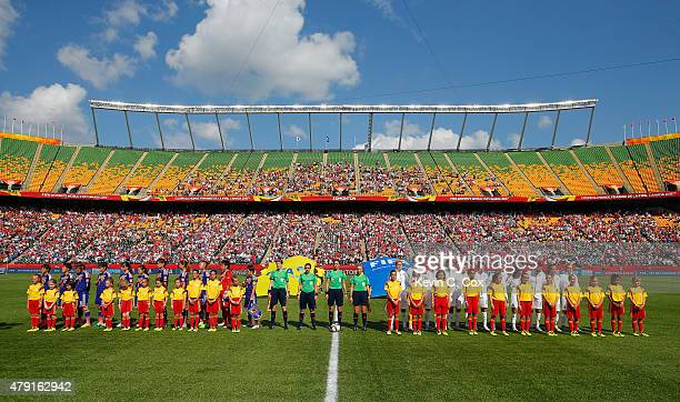 England and Japan line up before the FIFA Women's World Cup Semi Final match between Japan and England at the Commonwealth Stadium on July 1 2015 in...