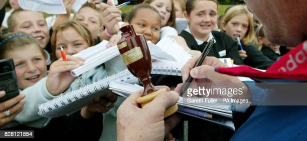 England and Kent wicketkeeper Geraint Jones signs autographs and shows off the the replica Ashes Urn at Canterbury High School Kent Thursday...