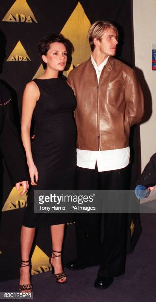England and Manchester United footballer David Beckham and his fiancee Victoria Adams of the Spice Girls at the launch of the Aida project a Disney...