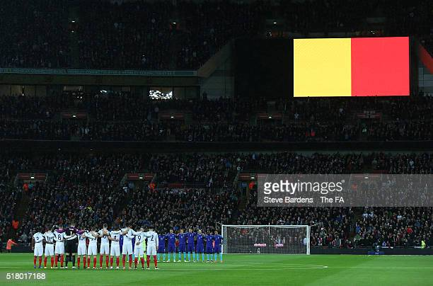 England and Netherlands players observe a minute of silence for the victims of Brussels terror attacks as the Belgium flag is shown on big screen...