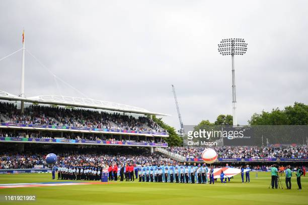 England and New Zealand observe the national anthems prior to the start of the Final of the ICC Cricket World Cup 2019 between New Zealand and...
