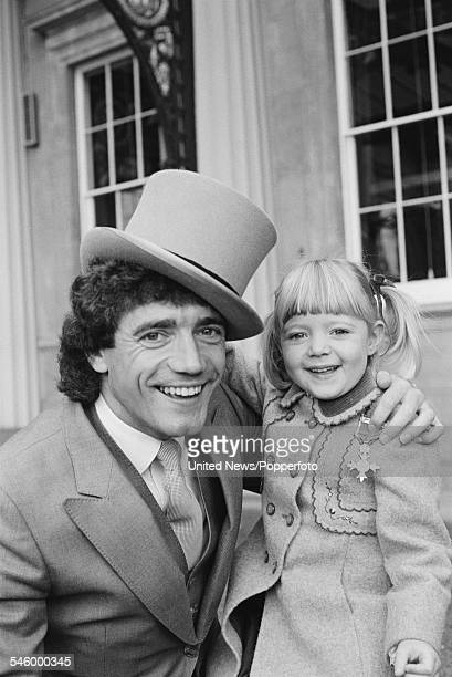 England and Newcastle United footballer Kevin Keegan pictured with his daughter after being awarded an OBE at an investiture ceremony at Buckingham...