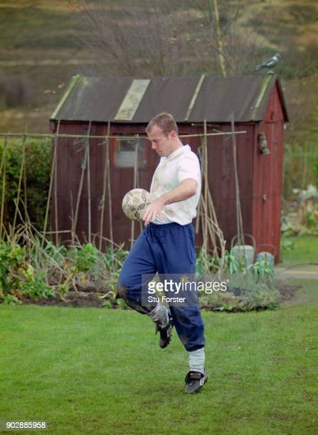 England and Newcastle United striker Alan Shearer in action during a Lucozade TV commercial shoot in a garden at a house in Tow Law County Durham on...