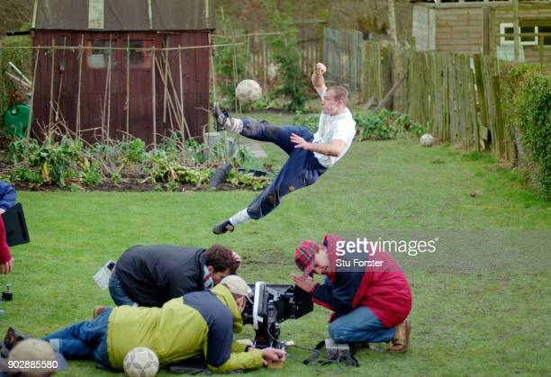 England and Newcastle United striker Alan Shearer in action during filming for a Lucozade TV commercial shoot at a house in Tow Law County Durham on...