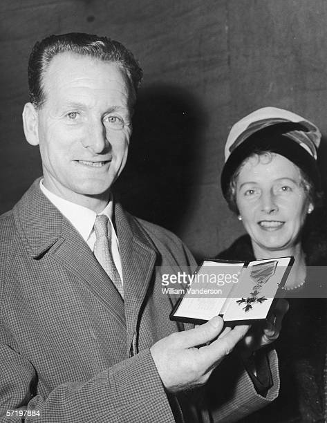 England and Preson North End footballer Tom Finney at Buckingham Palace, with his wife Elsie, to recieve his OBE, 24th October 1961.