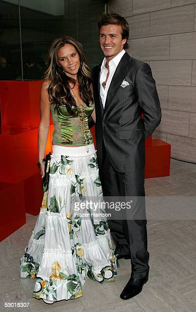 England and Real Madrid football player David Beckham and wife Victoria pose at The David Beckham Academy launch party at Creative Artists Agency on...