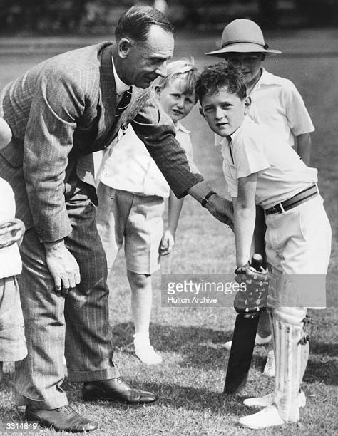 England and Surrey cricketer Jack Hobbs giving cricket lessons to boys at the annual Children's Garden Party Duke of York's barracks London