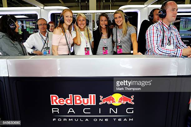 England and Team GB hockey players Nicola White Steph Elliot Maddie Hinch and Lily Owsley in the Red Bull Racing garage during qualifying for the...