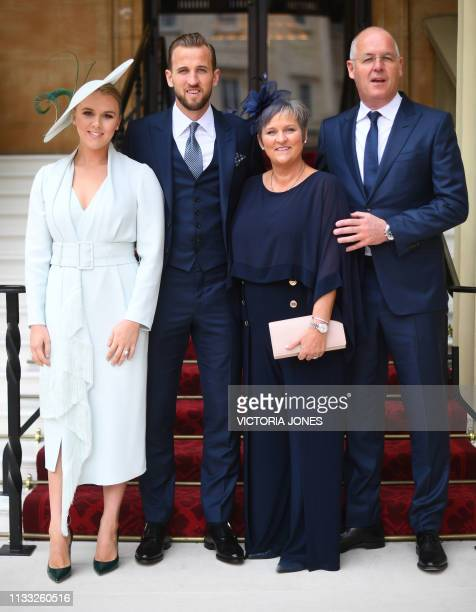 England and Totthenham Hotspur football player Harry Kane poses with his partner Kate Goodland and his parents Kim and Patrick Kane as they arrive at...