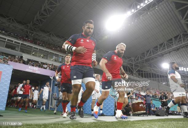 England and US players enter the pitch ahead of a Rugby World Cup Pool C match on Sept 26 in Kobe western Japan