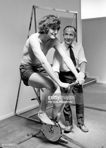 England and Warwickshire fast bowler Bob Willis recovering from operations on both knees with a session on a stationary bike supervised by team...