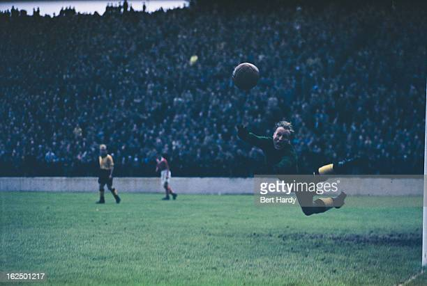 England and Wolverhampton Wanderers goalkeeper Bert Williams makes a save during a match against Charlton Athletic at The Valley Charlton London 11th...