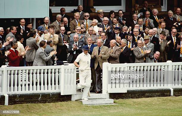 England and Yorkshire batsman Geoff Boycott makes his way through the MCC members on his way to opening the batting on his 100th Test match during...