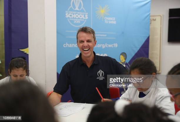 England and Yorkshire Cricketer David Willey watches over the kids as he takes part in the lesson during the Cricket World Cup Schools Programme at...